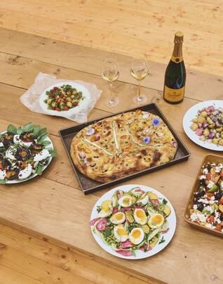 Assortment of summer salads and Veuve Clicquot focaccia